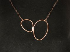 copper and sterling silver organic stone shapes necklace. $85.00, via Etsy.