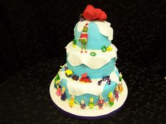 Grinch Cake - All of the character were made out of fondant. A friend helped me witht the who's. TFL!