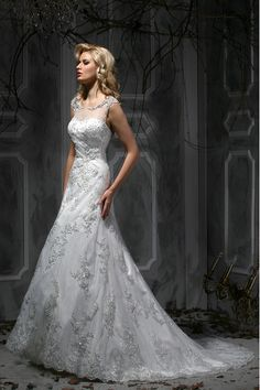 Stunning detailing on this wedding gown. And it has sleeves!