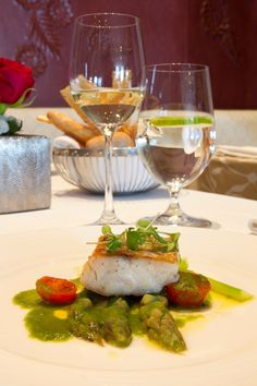 seared and roasted Sea Bass recipe comes to us from Hotel St. Regis' executive chef Guy Santoro. The rich greens and reds of the asparagus and tomato are a lovely compliment to the tender sea bass
