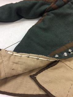 These pictures were taken at Jamestown - applying buttons using a strip of fabric