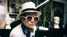 At Elton John still has the world's finest collection of glasses. Take a look back at his memorable shades. Elton John Sunglasses, Dearly Beloved, Christian Bale, The Clash, North Korea, Concert Posters, Photo Look, Led Zeppelin, John Lennon