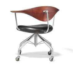 "Hans J. Wegner: ""Swivel Chair"". Very rare and early chair with teak back and polished steel frame, mounted on bakelite castors. Made by Johannes Hansen."