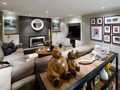 #CandiceTellsAll The entertainment area of the basement features a large sectional for the whole family to gather for movie night. To personalize the space, a simple art gallery of family portraits hangs on the wall. Design by Candice Olson