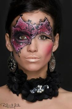 Creative purple and black crystal accented masquerade make-up mask.