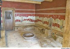 Throne room at Knossos, Crete. The wall is decorated with a fresco depicting griffins, fabled monsters having the head of an eagle and the body of a lion. Against the wall is an alabaster throne. The throne room in Palace F may have been decorated in a similar fashion.