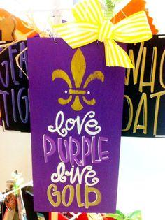 6x12 LSU Love Purple Live Gold with Fleur de Lis - LSU Tigers - Hand Painted Wood Sign, Door Hanger, College Team Sign. $28.00, via Etsy.