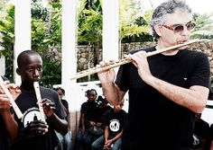 Andrea Bocelli: singer, flutist, humanitarian. // I didn't know he played flute. I wonder, is he any good?