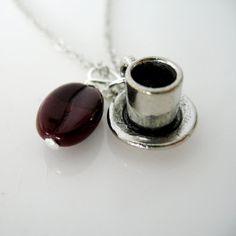 Coffee Bean & Cuppa Joe pendant on etsy.com   I think we need matching sets, ;)