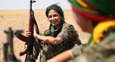 Female fighters from the Kurdish People Protection Unit (YPG) take a break on the front line in the northeastern Syrian city of Hasakeh on September 4, 2015.