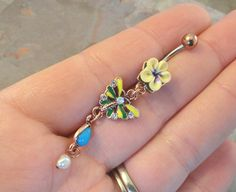 An inside joke you'll get when you read book one... MWahahaha Butterfly and Flower Yellow Belly Button Ring Jewelry, Travis from The Supernatural London Underground urban fantasy series. http://amzn.to/1X4rXpj
