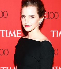Loving Emma Watson's pompadour updo and red lips