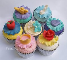 Disney princess cupcakes! Clockwise from top left: Jasmine, Cinderella, Ariel, Belle, Aurora, Snow White