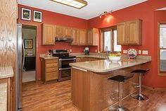 Gourmet kitchen features granite countertops, stainless steel appliances and eat-in space  3847 Tessier Trail, Vadnais Heights, MN 55127  http://www.movingtominnesota.com/property-item/gorgeous-vadnais-heights-home/