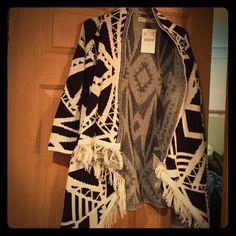 Long fringed sweater Really nice NWT. Size medium. Long fringed sweater Coat. 100% acrylic. Too small! I love this Sweater! Soft! Zoe Baer Sweaters Shrugs & Ponchos