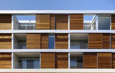 """Locals will recognize the sliding wooden panels of living spaces set atop the Tender Greens restaurant on Santa Monica Boulevard. Among the judges' comments: """"The permutation of the front façade is so interesting. By the moving of the screen, the tenant maintains control over his/her space, while also bringing character to the structure."""""""