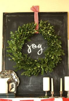 Great chalkboard with boxwood wreath and red gingham ribbon. Love this look!!!