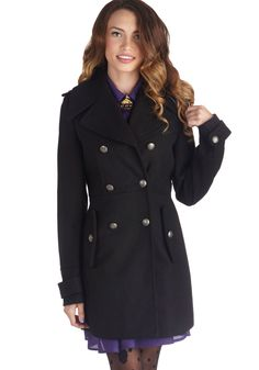 Take in a bit of history as you keep off the chill in this double-breasted black coat! Secure the pewter, crest-embossed buttons of this long look above red skinnies and faux-fur trimmed boots, and join your fellow academics on a fog-wrapped tour of the site. With your teal mittens snug in the side pockets of this tab-accented coat, you indulge in old-timey anecdotes and fascinating facts in modern style.