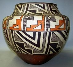 """Native American Historic Acoma Polychhrome Olla 920. Description: Native American, historic Acoma Polychrome Olla, having rain cloud and geometric designs. Dimensions: Approximate height 11"""", diameter"""