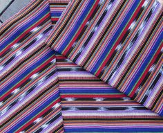 This fabric was hand woven on a treadle loom in the highlands of Guatemala…