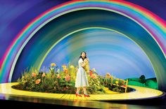 Danielle Hope as Dorothy with Toto - photo: Keith Pattison. Really Useful Group production of The Wizard of Oz.