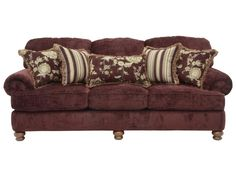 This sofa offers traditional style with deep seating comfort that works wells for informal relaxing and more formal entertaining. The luxurious textured diamond motif Umber chenille fabric offers plush comfort that complements the four red and gold prints of the kidney pillow and four accent pillows with fringe. Reversible box welted seat cushions, solid wood turned bun feet, and rolled arms round off the sophisticated look. Complete your room with the coordinating loveseat, chair and a…