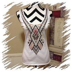 "MUST HAVE TANK WITH AZTEC PATTERN Like new worn one time. White knit tank with great colors in an Aztec/southwest design to compliment many things in your wardrobe. 51% cotton/44% rayon/5% nylon Approximate measurements: underarm to underarm 16"" and 24"" in length Etcetera Tops Tank Tops"