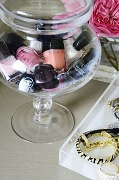 nail polish collection in a large apothecary jar or vase