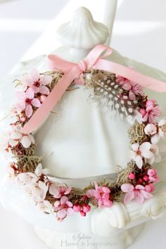 Darling little wreath with blossoms & feather.  Makes me happy…YOU?