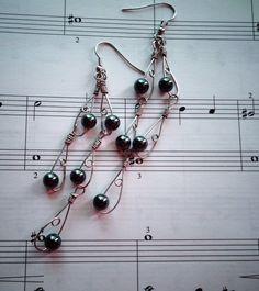 #fashionjewelry #blacksilverearrings #beadedearrings #longearrings #fashionjewelry #metalearrings #wireearrings
