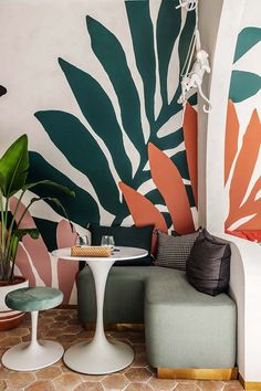 Hui Designs combines French joie de vivre with a relaxed tropicana mood in Merci Marcel Orchard Orchard Road Singapore, Bauhaus Architecture, Terracotta Floor, White Wash Brick, Parisian Cafe, Tulip Table, Sofa Frame, Bar Seating, Ceiling Panels