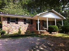 Brick home with woods in back, The home has 3 bedrooms, open living area, storage building. Great home for small family or excellent rental property in Selmer TN