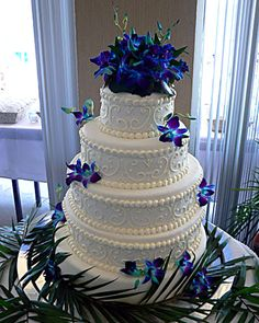 Blue Orchid wedding cake:) So beautiful.  Not all that crazy about the designs on the cake, but absolutely love the contrasting colors<3