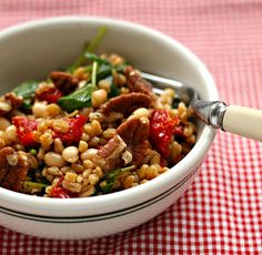 Farro and kale salad made w/ white beans, slow-roasted tomatoes, and pecans complete w/ a mustardy balsamic vinaigrette