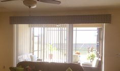 Dress up your vertical with a cornice board.  Available at Budget Blinds