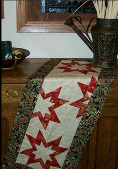 Star table runner pattern at https://www.facebook.com/photo.php?fbid=606253776095575&set=a.474000589320895.1073741828.473498709371083&type=1&theater