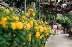 walking int he beautiful garden of Grand Hotel Amalfi