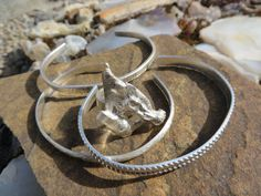 Some of our newest pieces....upcycled silver jewelry.  Bangles and a silver adjustable ring made with some silver scrap we had. www.sandyriverjewelry.com