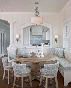 breakfast nook, love the sconces and matching art glass pendant light.
