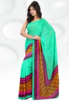 Sea green faux georgette saree designed with geometrical, floral and stripes print. Available with sea green faux georgette blouse. The blouse can be customized from 34 to 44 inches. (Slight variation in color and print pattern is possible.) data-pin-do=