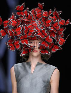Alexander McQueen - Butterfly headdress of hand-painted turkey feathers.