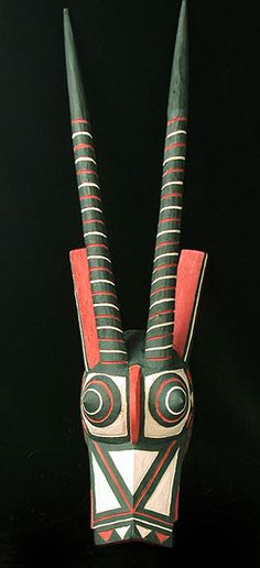 Antelope mask Bobo people, Burkina Fasso 28 inches, painted wood  Two antelope masks, called Kaan, rest between dances. Their ritual role is to remove any vestiges of negative energy that have accumulated in the community since the last harvest.