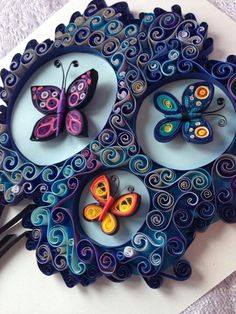 I love the colors in this quilled butterfly art!