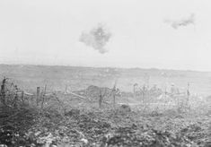 Troops dig themselves in while shrapnel bursts overhead, Vimy Ridge, 1917.