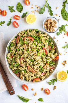 A Mediterranean diet inspired pesto pasta salad that is loaded with veggies and tossed in a dairy-free walnut pesto sauce. The perfect dish to bring to summer parties and cookouts! Vegan and gluten-free.