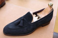 Gotta have huge ones to pull off navy suede tassel loafers