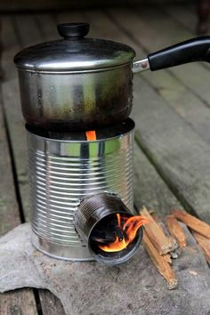 Make a hobo tin-can portable rocket stove for cooking in an emergency when the power goes out, for a camp out or just for fun... logcabincooking.c...