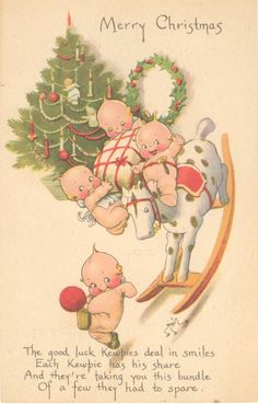 Antique Christmas themed postcard featuring Rose O'Neill illustrations of the Kewpies.