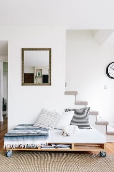 Kari Jensen's St. Paul home includes this pallet bench for lounging. Magazine and book storage is built right in. Reclaim an old pallet and add wheels or build your own pallet style bench for a useful DIY addition to nearly any room in your home.