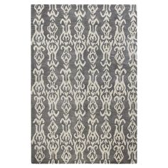 Anchor your living room seating group or define space in the den with this eye-catching wool rug, featuring an ikat motif for exotic appeal....